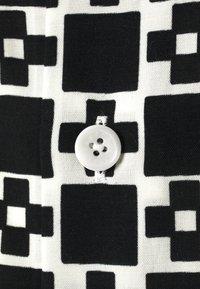sandro - CROSS - Shirt - noir - 3