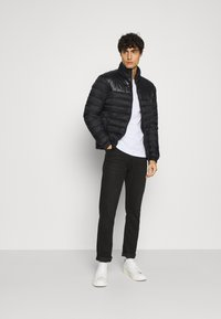 Selected Homme - SLHNATHAN PUFFER - Light jacket - black - 1