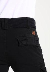 Schott - TRRANGER - Cargo trousers - black - 4