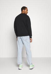 Calvin Klein - NECKLINE LOGO - Sweatshirt - black - 2