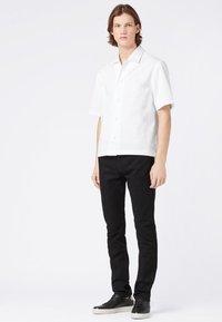BOSS - DELAWARE - Slim fit jeans - black - 1