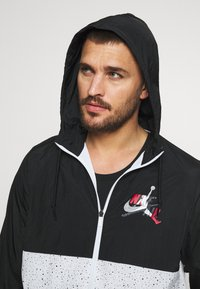 Jordan - WINDWEAR - Windbreaker - black/white/gym red - 3