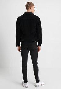 Levi's® - TYPE 3 SHERPA TRUCKER - Denim jacket - black cord better - 2