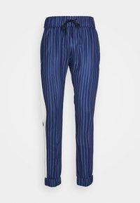 LIBERTY - Teplákové kalhoty - navy/white