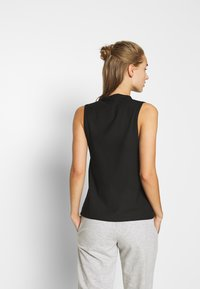 Puma - Camiseta de deporte - black - 2