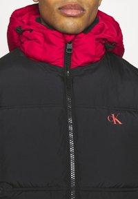Calvin Klein Jeans - COLOURBLOCK PUFFER - Winter jacket - black/ white / red - 4
