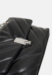 ALDO - RHILADIA - Across body bag - jet black/silver-coloured - 3