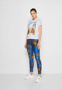 Versace Jeans Couture - PANTS - Leggings - blue/gold - 1