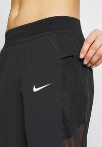 Nike Performance - PANT RUNWAY - Pantalones deportivos - black - 5