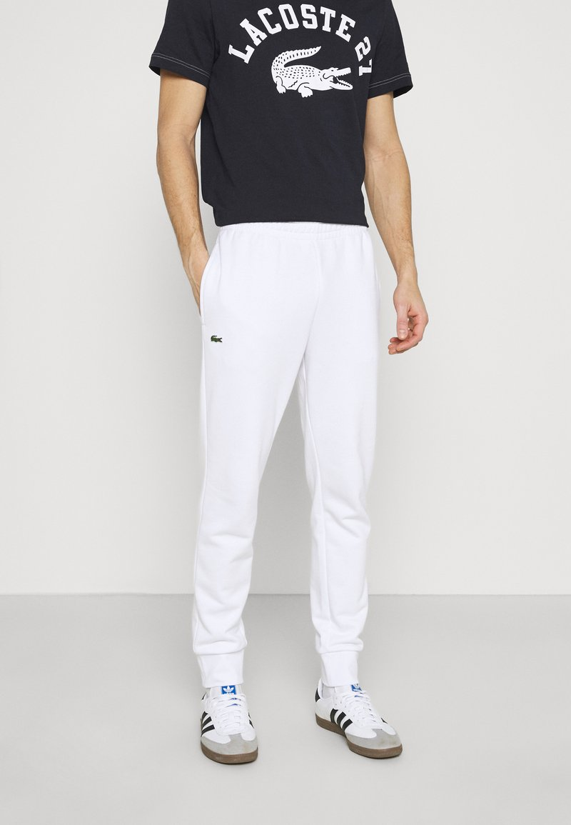 Lacoste - Tracksuit bottoms - white