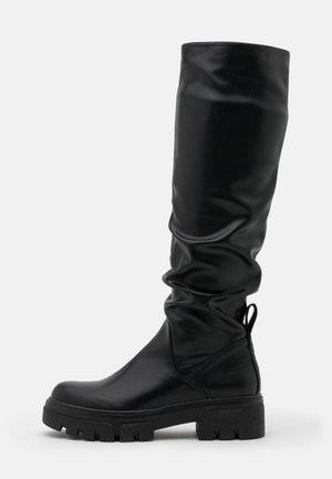VEGAN HANNA WARSAV - Platform boots - black