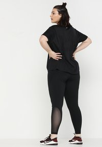 Nike Performance - Leggings - black/white