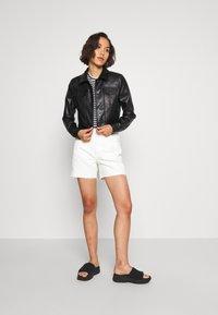 ONLY - ONLVIBE TRUCKER JACKET - Faux leather jacket - black - 1
