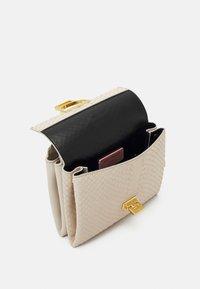 Coccinelle - ARLETTIS PYTHON LULULA - Handbag - white - 2