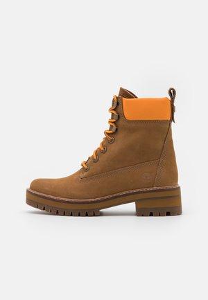 COURMAYEUR VALLEY BOOT - Platform ankle boots - medium brown