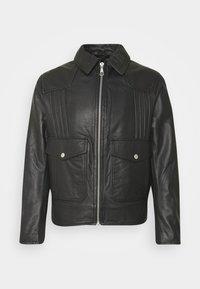 NOSKUT - Leather jacket - black