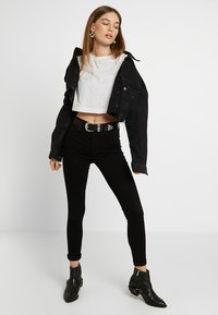 Topshop - LEIGH NEW - Jeans Skinny Fit - black - 1
