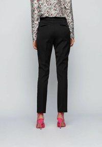 BOSS - TAXTINY - Trousers - black - 2