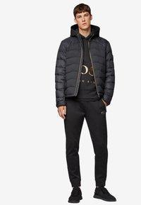 BOSS - HALBOA - Spodnie treningowe - black/gold - 1