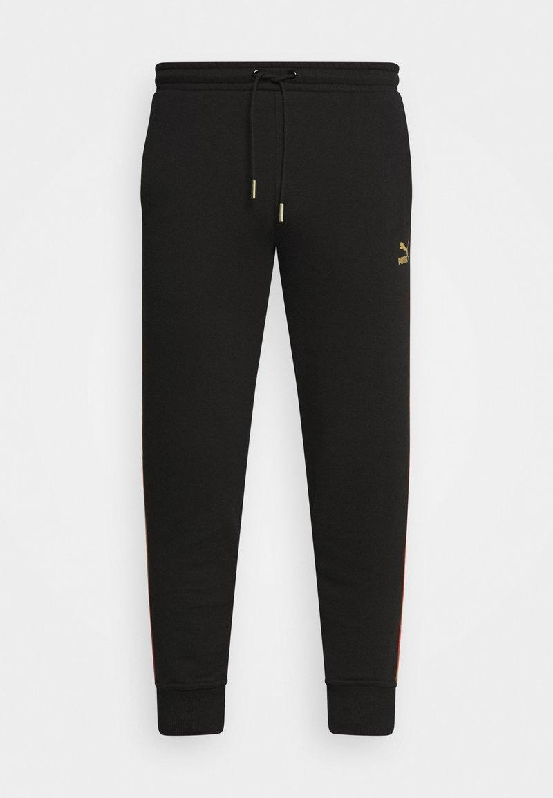 Puma - WORLDHOOD TRACK PANTS - Jogginghose - black