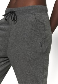 Nike Performance - Tracksuit bottoms - smoke grey - 4
