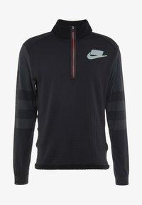 Nike Performance - WILD RUN MIDLAYER - Koszulka sportowa - black/off noir/silver - 4