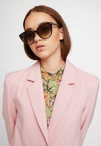 Alexander McQueen - Sunglasses - brown - 1