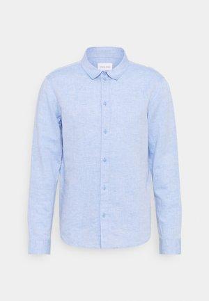 Skjorta - mottled blue