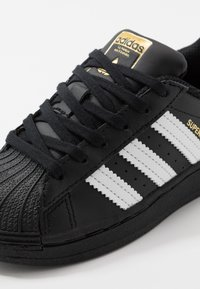 adidas Originals - SUPERSTAR - Trainers - core black/footwear white