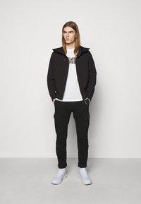 C.P. Company - PANTS - Cargo trousers - black - 1