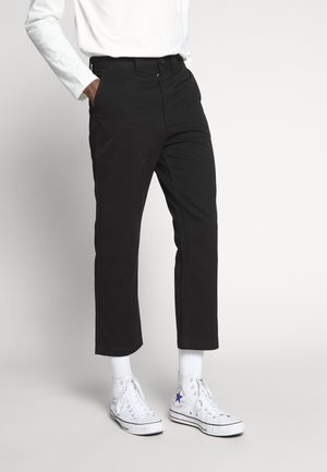 TILO TROUSERS - Tygbyxor - black