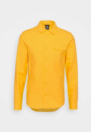 SOLID UNISEX - Overhemd - university gold