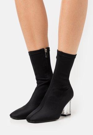DORI - Classic ankle boots - black