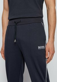 BOSS - CUFFED - Tracksuit bottoms - dark blue - 3