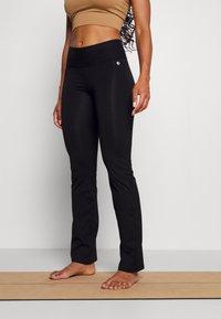 Deha - TIGHT PANTS - Tracksuit bottoms - black - 0