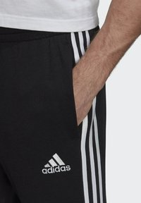 adidas Performance - ESSENTIALS FRENCH TERRY TAPERED 3-STRIPES JOGGERS - Pantalones deportivos - black - 3