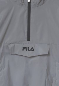 Fila - RAY REFLECTIVE WOVEN UNISEX - Light jacket - silver