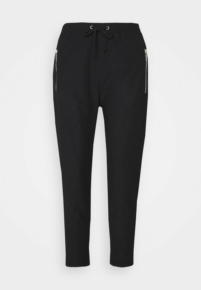JOGGER - Tracksuit bottoms - black