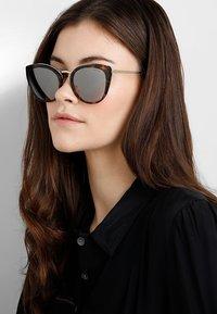 Prada - Sunglasses - brown - 1