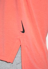 Nike Performance - DRY TANK YOGA - Sports shirt - magic ember/black - 5