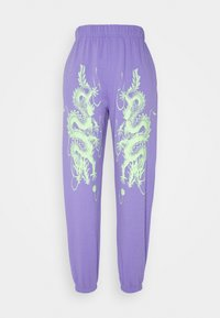 NEW girl ORDER - DRAGON JOGGERS - Tracksuit bottoms - lilac - 0