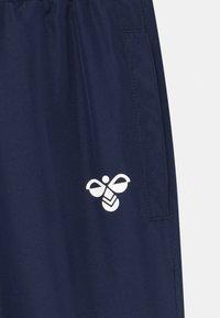 Hummel - SPOT UNISEX - Tracksuit bottoms - dark blue - 2