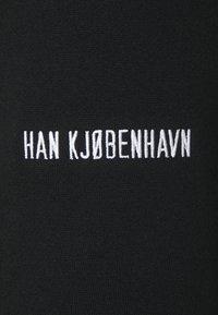 Han Kjøbenhavn - PANTS - Teplákové kalhoty - black - 6