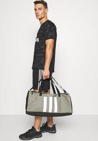 adidas Performance - Sports bag - green/black/white - 0