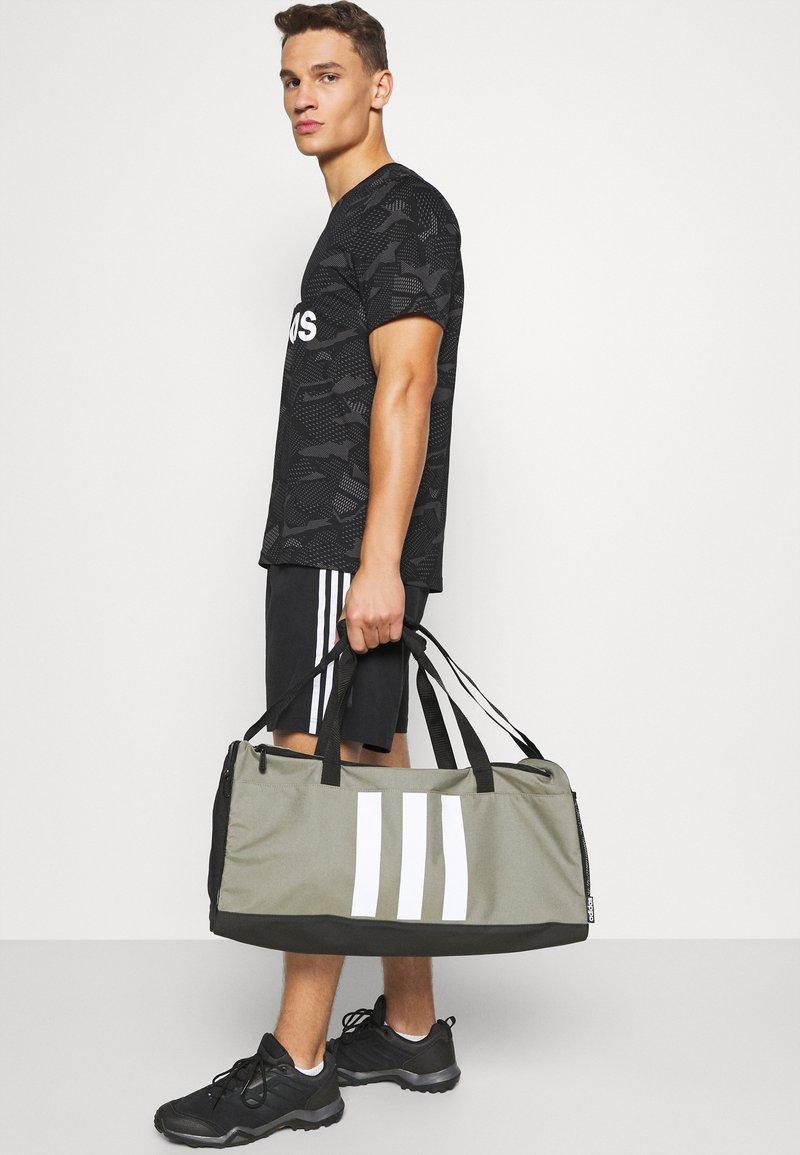 adidas Performance - Sports bag - green/black/white