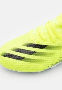 adidas Performance - X GHOSTED.3 FG UNISEX - Moulded stud football boots - solar yellow/core black/royal blue - 5