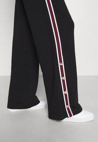 Iceberg - PANTS - Pantalones deportivos - black - 5