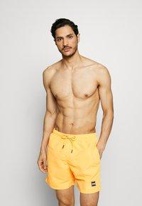 Urban Classics - BLOCK SWIM 2 PACK - Swimming shorts - orange/black - 1