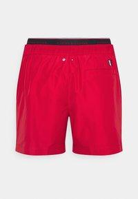 Tommy Hilfiger - LOGOLINE MEDIUM DRAWSTRING - Swimming shorts - red - 7
