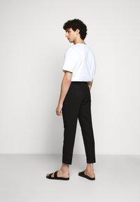 Filippa K - TERRY CROPPED SLACKS - Trousers - black - 2